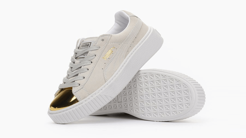 white pumas with gold tip