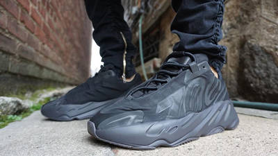 Yeezy Boost 700 MNVN Triple Black On Foot Front