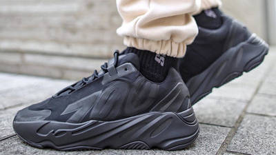 Yeezy Boost 700 MNVN Triple Black On Foot Side