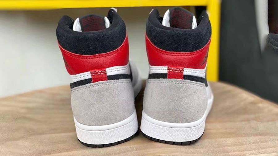 Air Jordan 1 Retro High Light Smoke Grey Lifestyle On Stool Back