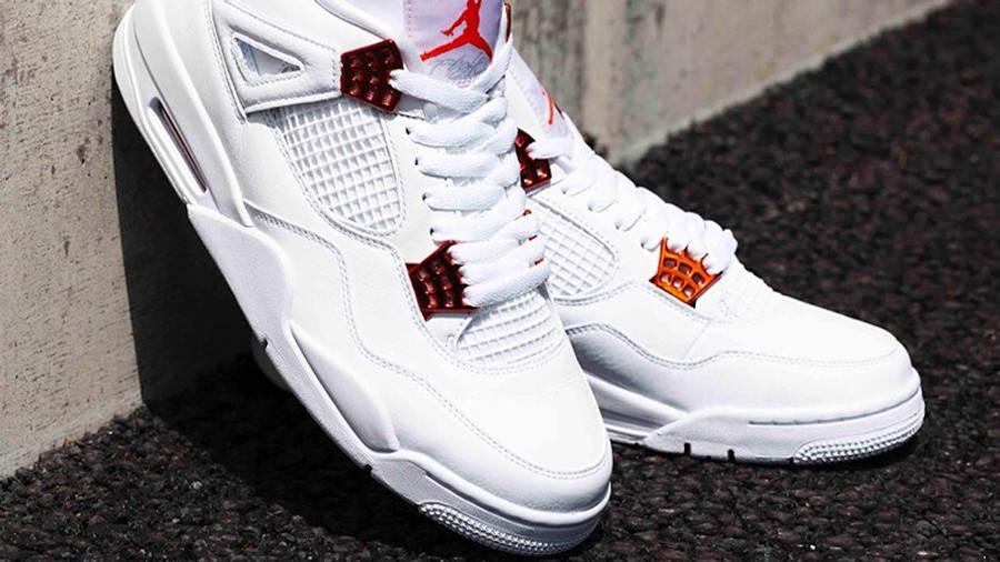 Jordan 4 Metallic Pack White Orange Lifestyle on wall