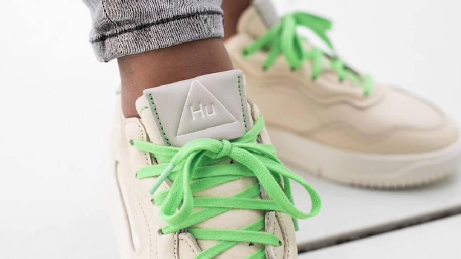Pharrell Williams x adidas SC Premiere Ecru Tint On Foot Closeup