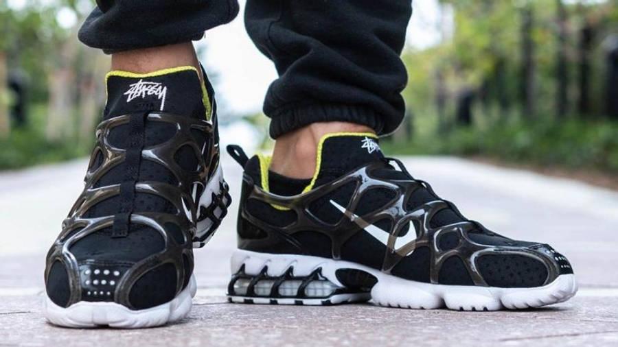 Stussy x Nike Air Zoom Spiridon KK Black on foot front