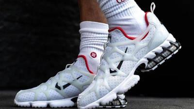 Stussy x Nike Air Zoom Spiridon KK White on foot side