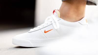 Nike SB Zoom Bruin White Orange AQ7941-101 on foot close up