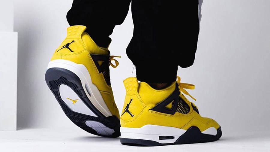 Jordan 4 Lightning on foot back