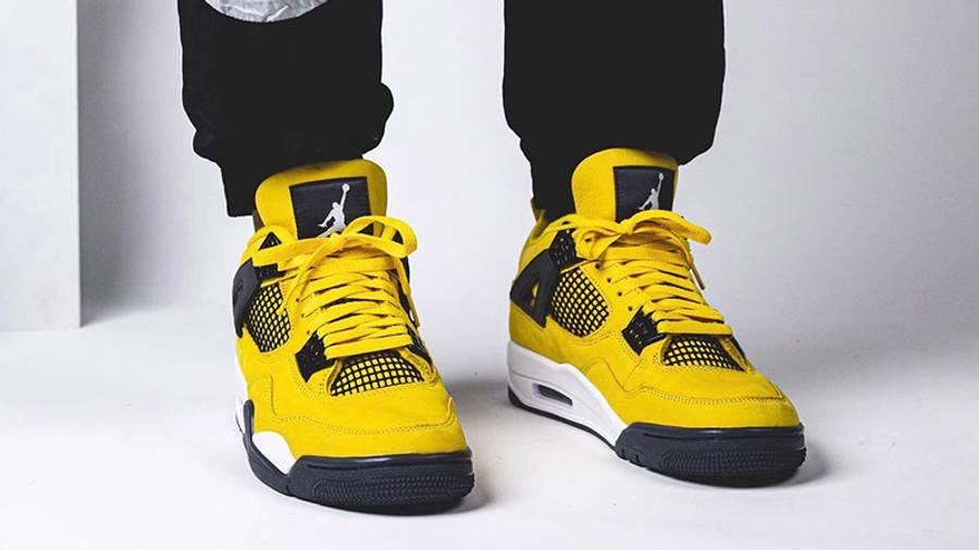 Jordan 4 Lightning on foot closeup