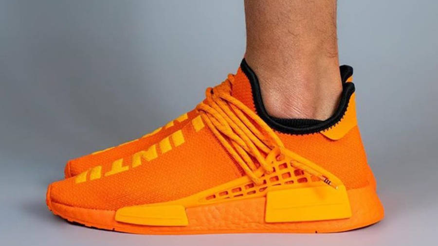 Pharrell x adidas NMD Hu Bright Orange On Foot Side