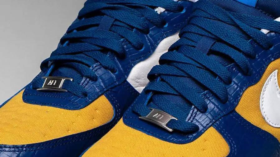 UNDEFEATED x Nike Air Force 1 Low Blue Croc DM8462-400 on foot closeup tongue tab