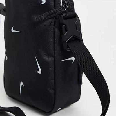 Nike Heritage All Over Logo Print Flight Bag Black Side